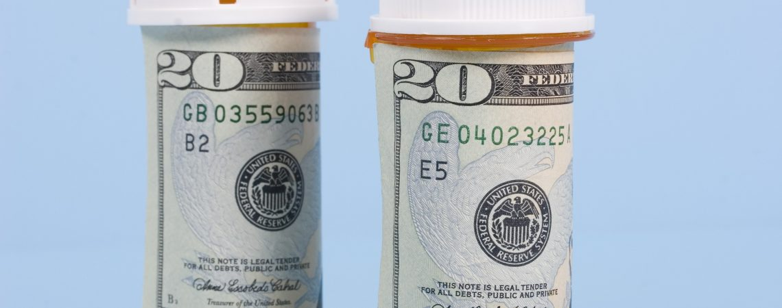 Prescription pill bottles wrapped in twenty dollar bills discounted with Medicare Part D